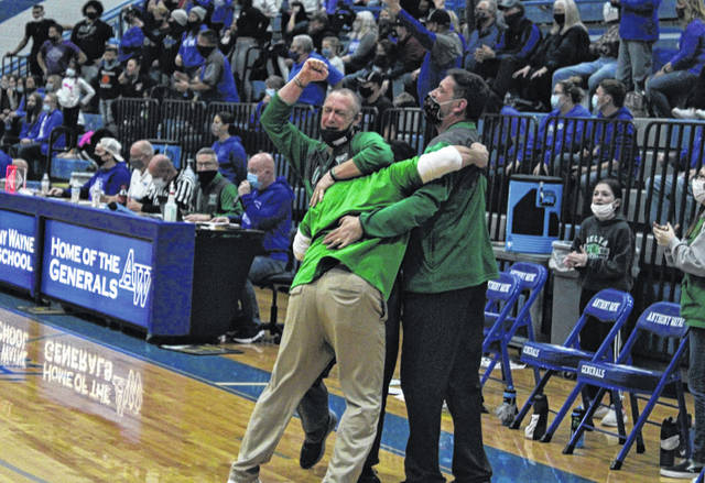 An emotional Ryan Ripke, left, celebrates with assistant coaches Jon Mignin and Ron Rouleau after Delta hung on for a victory over Elmwood in a D-III girls basketball district championship game this season. Ripke stepped down from his post after the season and leaves with a career record of 182-82.