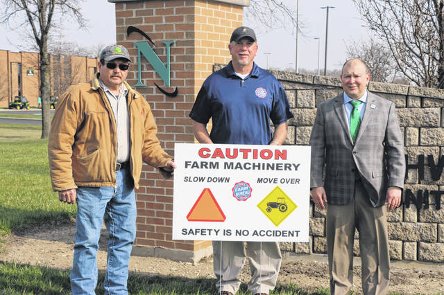 Northwest State Community College President Todd Hernandez (far right) joined Ohio Pork Producers Council member Mike Miller (far left) and Roy Norman (center) from the Ohio Farm Bureau in asking drivers to use caution at all times, especially during planting and harvest. Agriculture is a major part of the region's economy.