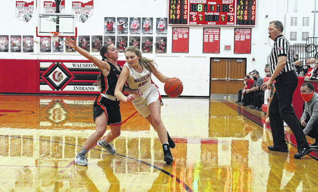 Marisa Seiler of Wauseon drives on a Liberty Center defender in a league game this season. She was selected third team All-Ohio in Division III.
