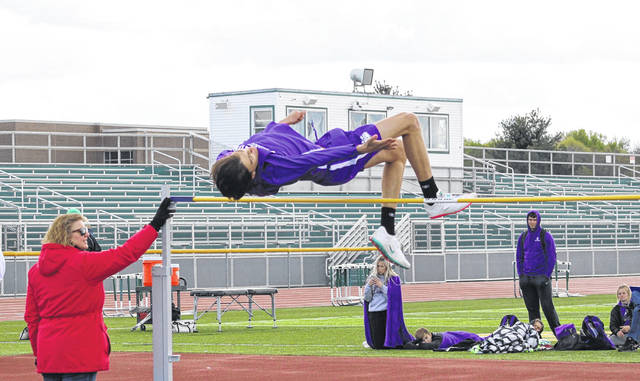 Kayden Davis of Swanton gets over the bar in the high jump during the NWOAL Track and Field Championships earlier this month. Last week, he set the meet record at the D-II Defiance District by clearing 6 feet, 5 inches.