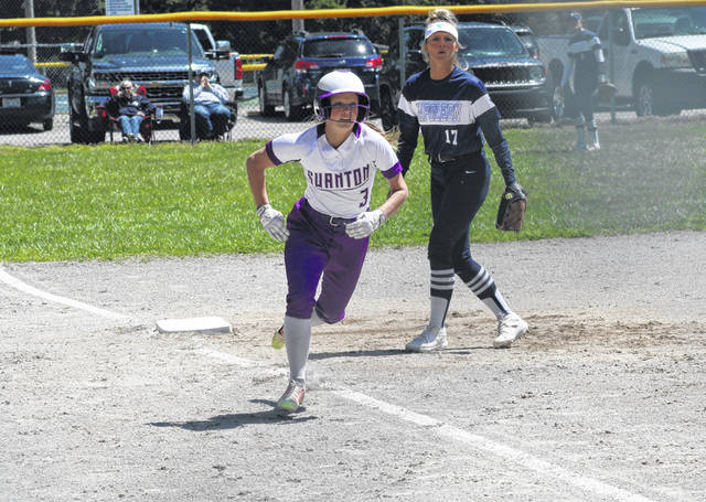 Swanton's Jayden Hendricks comes home on a wild pitch in the bottom of the third inning versus Napoleon Saturday. The Bulldogs bested the Wildcats 6-3 a day after losing in extra innings to Evergreen, 7-6.
