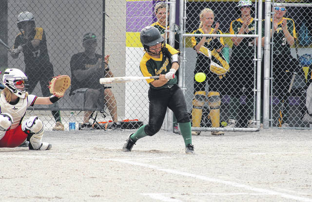 Marissa Van Denk of Evergreen prepares to hit a ball but fouls it off Monday in a Division III district semifinal with Otsego at Maumee's Rolf Park. The Vikings saw their season come to an end by way of a 4-0 loss to the top-seeded Knights.