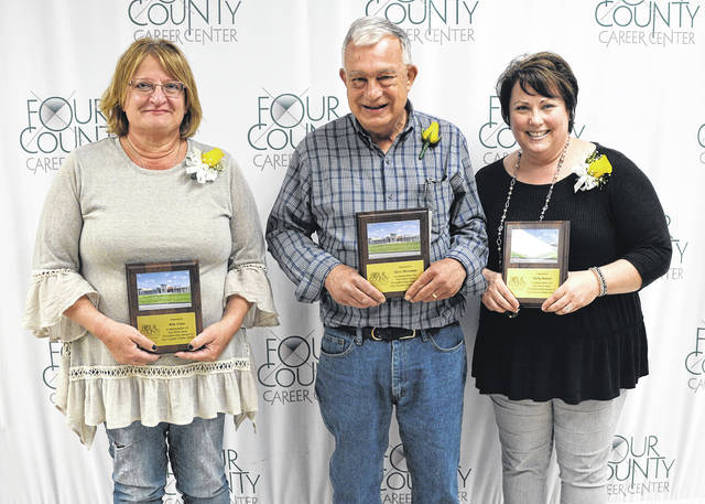 Shown, from left, are retirees Kim Arnos, 36 years, Industrial Services instructor; Steve Hootman, 37 years, Auto Collision Repair instructor; and Maria Barnes, 32 years, Job Training coordinator. Absent from the photo are Terry Eis, 14 years, Building and Grounds supervisor; and Nancy Gray, 31 years, Adult Education secretary.