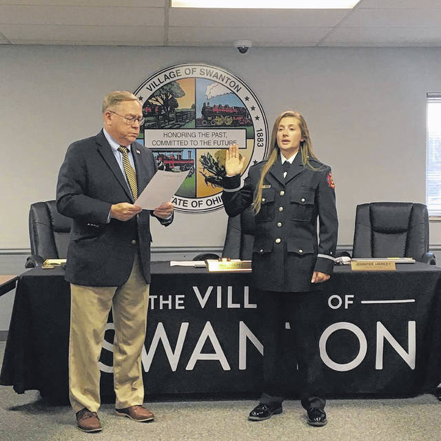 Mayor Neil Toeppe ceremonially swears in Kate Cleland as a lieutenant for Swanton Fire and Rescue.