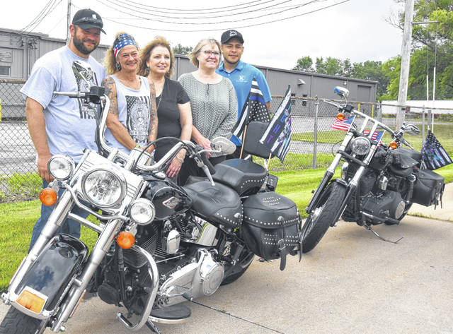 The fifth annual Dennis Deeds Suicide Awareness Bike Ride, organized by Julie Deeds, her son Justin and their friends, raised $9,500 this year. Pictured, from left, are Justin Deeds; Julie Deeds; Wendy Jennings, executive director of NAMI Four County; Jenny Hoeffel, program manager of Maumee Valley's veterans outreach program; and Mike Ramirez, a veteran who works for Keller Logistics.