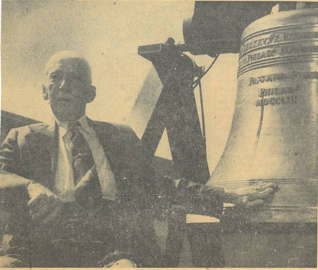 """Ohio's last surviving Civil War veteran, age 103, rings a replica of the Liberty Bell in Wauseon in June 1950. The bell is one of 52 reproductions made in France as part of the 1950 Independence Savings Bond Drive. This bell toured all 88 of Ohio's counties and is currently on exhibit at the Ohio State House in Columbus. """"Uncle"""" Dan Clingaman was born in New York and came to Fulton County as a youngster in 1853. His parents settled in German Township. At age 18, Uncle Dan enlisted in the Union Army and served with the 195th Ohio Volunteer Infantry Regiment. After the war, he became a blacksmith in Spring Hill (now Tedrow) and Wauseon. Later he would become a farmer purchasing property north of Wauseon and building a Victorian House. When he died he was 104 years, 4 months, and 23 days old, there were only four other veterans surviving him and newspapers around the country ran stories of his passing."""