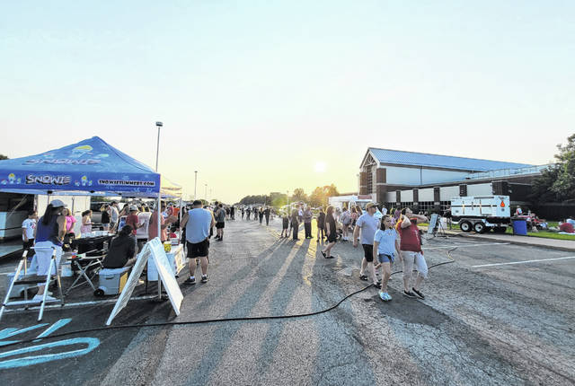The crowd gathers for Swanton's Fireworks Fest on Saturday as the sun begins to set.