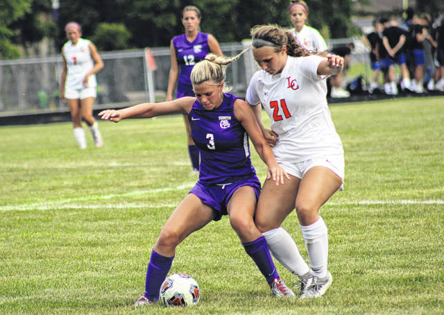 Macy Pawlowicz of Swanton closes off Liberty Center's Alyssa Giesige to a ball during Thursday's NWOAL girls soccer match at Swanton. The Bulldogs fell to the Tigers 2-1.