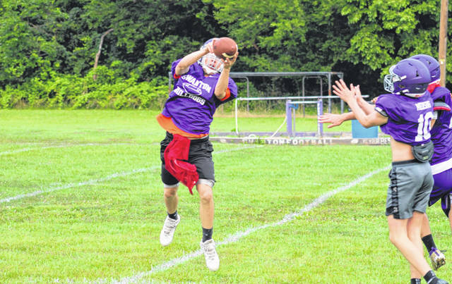 Kyler Stevens intercepts a pass during a drill at Swanton's football practice Sunday morning. The Bulldogs' season officially got underway with a midnight practice Saturday night.