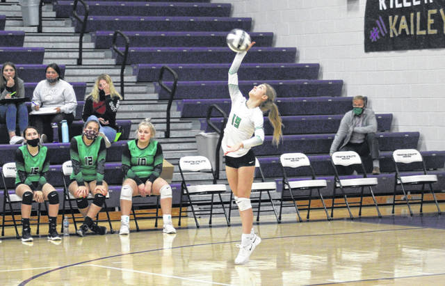 Khloe Weber serves a ball for Delta in a match at Swanton last season. She is back for her junior season in 2021.