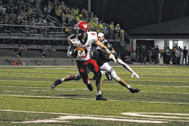 Wauseon receiver Jude Armstrong makes a catch and run last Friday at Liberty Center.