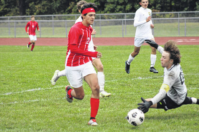 Eli Delgado of Wauseon gets past a diving Evergreen goalkeeper Jon Burnep for his second of three goals in the NWOAL matchup with the Vikings Thursday. The Indians bested the Vikings 6-1.