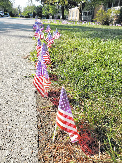 """Swanton Middle School students took a moment on Friday to remember 9/11 on its 20th anniversary. Students placed a flag in the ground in rememberance of each individual who died that day in 2001. They will now begin a schoolwide book study of the novel """"Towers Falling."""""""