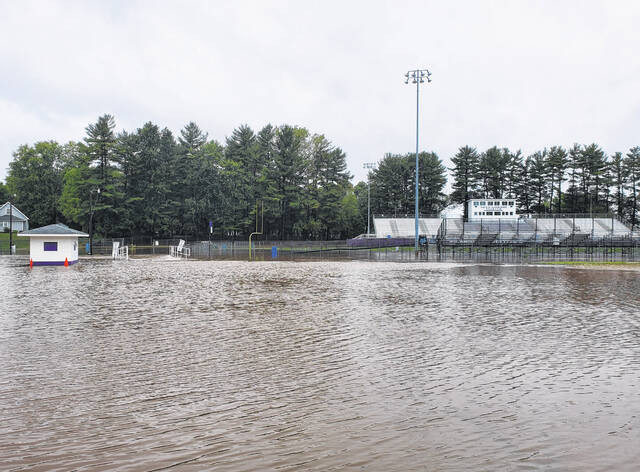 The surrounding area and parts of the field at Hansbarger Stadium in Swanton are covered in water last week.