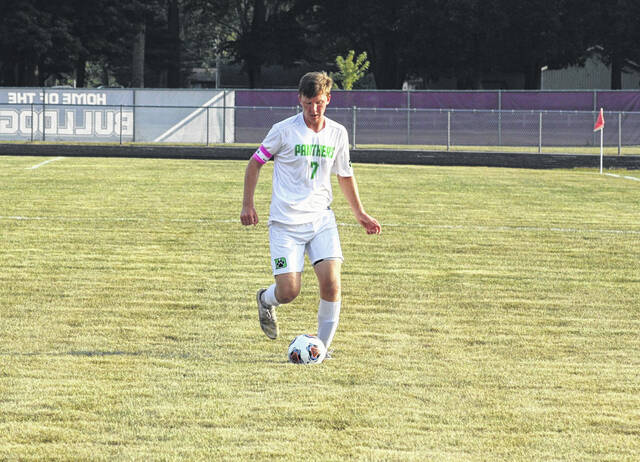 Nolan Risner of Delta advances the ball upfield in a NWOAL match at Swanton Tuesday, Sept. 14. He recorded a goal and two assists in helping the Panthers defeat the Bulldogs 11-2.