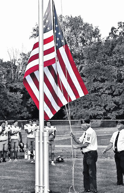 Lieutenant Colonel Bob Janes and the Swanton American Legion members present the colors prior to the Ottawa Hills-Swanton home football game on Friday, Aug. 27.