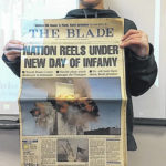 SMS student brings in newspaper for 9/11 book reading