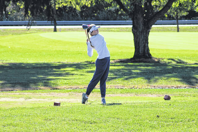 Brayton Huffman of Archbold off the tee during the NWOAL Championships on Sept. 24. She was named NWOAL Player of the Year upon taking first at the league tournament.