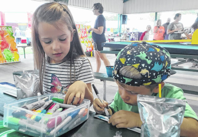 Addison Griffith, 6, and Colton Griffith, 4, of Wauseon get busy with an art project.