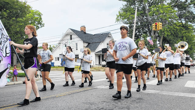 The Swanton High School band marches in the Corn Festival.