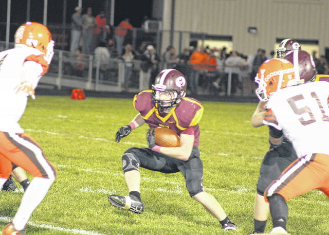 Meigs junior Zach Bartrum carries the ball during Friday night's Week 6 TVC Ohio football contest against Nelsonville-York in Rocksprings, Ohio.