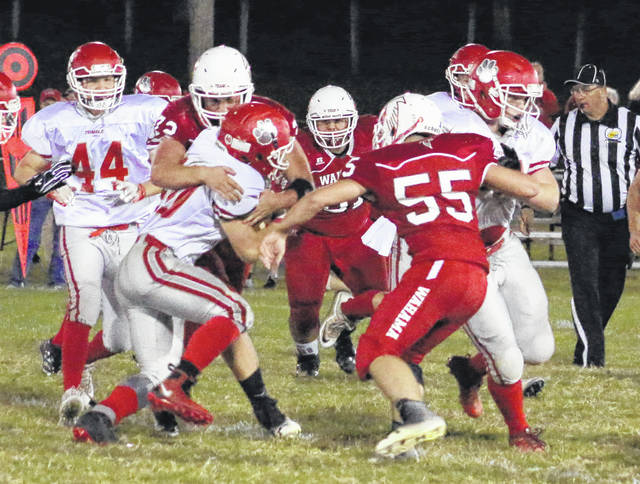 Wahama junior Zach Marr wraps up Trimble running back Conner Wright for a tackle during the second quarter of Friday night's Week 6 TVC Hocking football contest in Mason, W.Va.