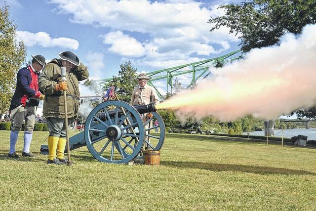 The cannon fires to conclude the memorial service at Battle Days.