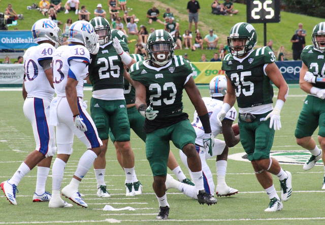 Ohio Kylan Nelson (23) celebrates a tackle in front of teammates Tyler Gullett (25) and Dylan Conner (35) during the Bobcats' win over Kansas on Saturday in Athens, Ohio. (Alex Hawley|OVP Sports)