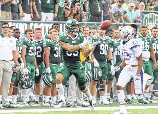 Ohio's Brendan Cope catches a pass in front of Kansas' Hasan Defense (13) during the Bobcats' 42-30 win on Saturday in Athens, Ohio.