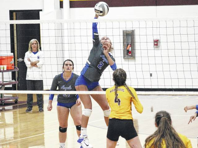Gallia Academy sophomore Peri Martin (2) spikes the ball in front of teammate Taylor Burnette, during the the Blue Angels' straight games win over Meigs on Monday in Rocksprings, Ohio.