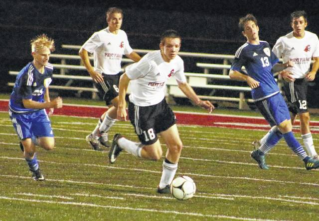 Point Pleasant sophomore Peyton Hughes (18) steals a possession away from Huntington Saint Joseph during a Sept. 12 match at OVB Field in Point Pleasant, W.Va.