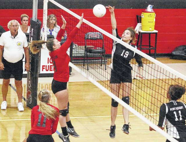 Point Pleasant freshman Tristan Wilson (19) hits a spike attempt during Game 3 of Tuesday night's volleyball match against Nitro in Point Pleasant, W.Va.