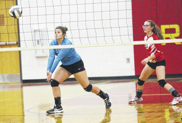 Wahama libero Harley Roush (21) returns a South Gallia serve as teammate Hannah Billups (11) looks on during Tuesday night's Tri-Valley Conference Hocking Division volleyball match in Mercerville, Ohio.