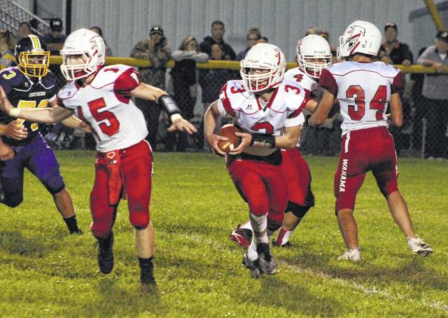 Wahama senior Bryton Grate (3) looks for a lead block from classmate Johnnie Board (15), during the White Falcons' six-point loss on Sept. 8 in Racine, Ohio.