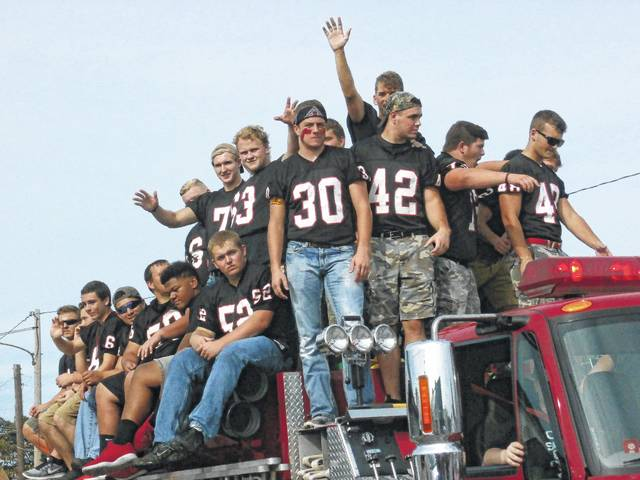 Pictured are members of the PPHS Big Blacks varsity football team in Friday's homecoming parade in Point Pleasant. More photos from the parade appear inside and online at www.mydailyregister.com.
