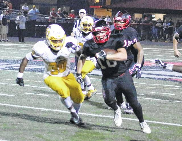 Point Pleasant senior Justin Brumfield (10) eludes a Mount View defender during the second quarter of Friday night's Week 5 Homecoming contest at OVB Field in Point Pleasant, W.Va.