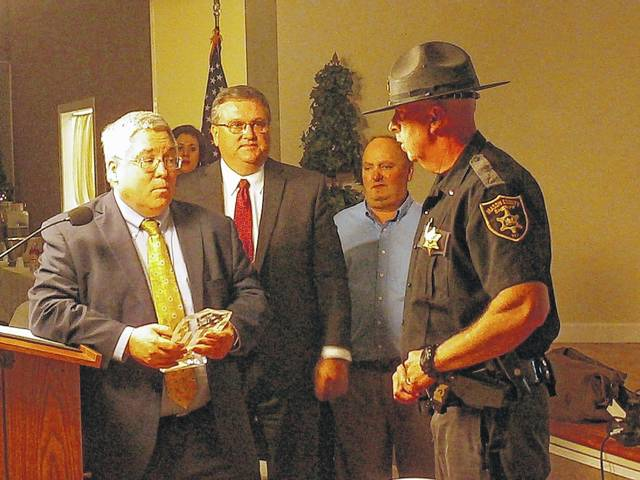 West Virginia Attorney General Patrick Morrisey, at left, presents Lt. Troy Stewart, far right, with the Officer of the Year Award. Also pictured, Bryan Stepp and Tim Martin, of Point Pleasant Rotary.