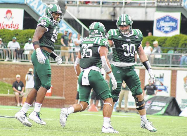 Bobcats Kevin Robbins (96), Dylan Conner (35) and Trent Smart (90) celebrate a sack during Ohio's 42-30 non-conference victory over Kansas on Sept. 16 in Athens, Ohio.
