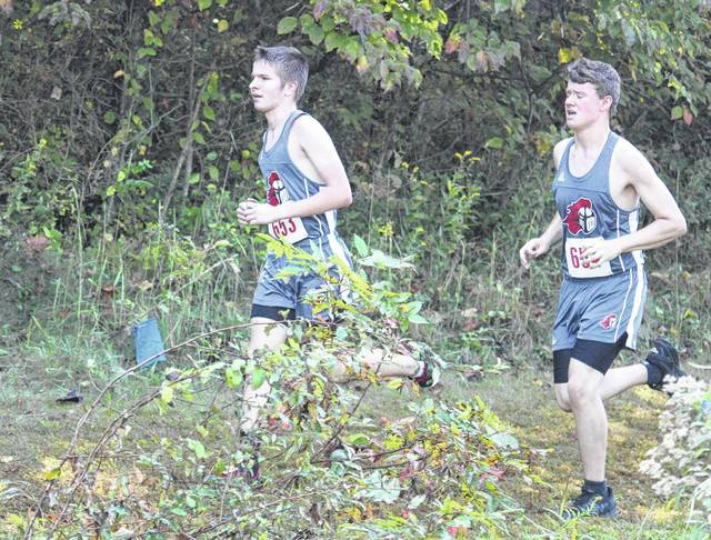 Point Pleasant's Isaac Daniels (left) and Tanner Durst (right) compete in the boys high school race as part of Saturday's Patty Forgey Cross Country Invitational in Rio Grande, Ohio.