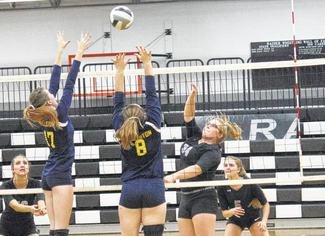 River Valley's Kelsey Brown (34) goes up at the net over Wellston's Hannah Stewart (17) and Tory Doles (8) during Tuesday night's Tri-Valley Conference Ohio Division volleyball match in Bidwell, Ohio.