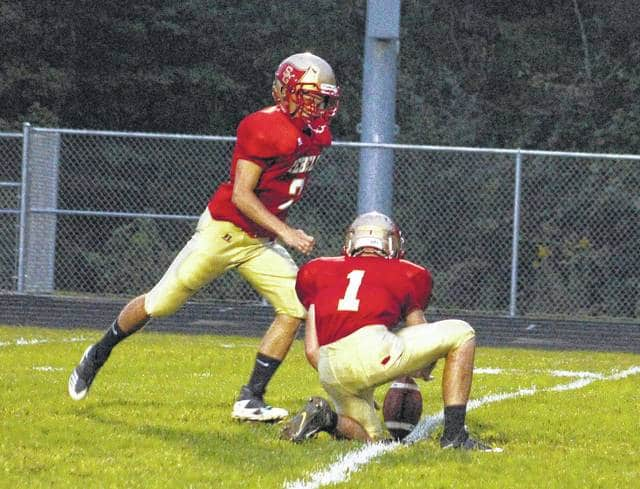South Gallia kicker Sviatoslav 'Savat' Hryhorenko runs up on a point-after try during a Week 4 non-conference football contest against Manchester in Mercerville, Ohio.