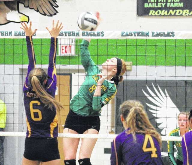 Eastern junior Allison Barber (8) attempts a spike over Southern's Phoenix Cleland (6), during the Lady Eagles' straight games win on Thursday in Tuppers Plains, Ohio.