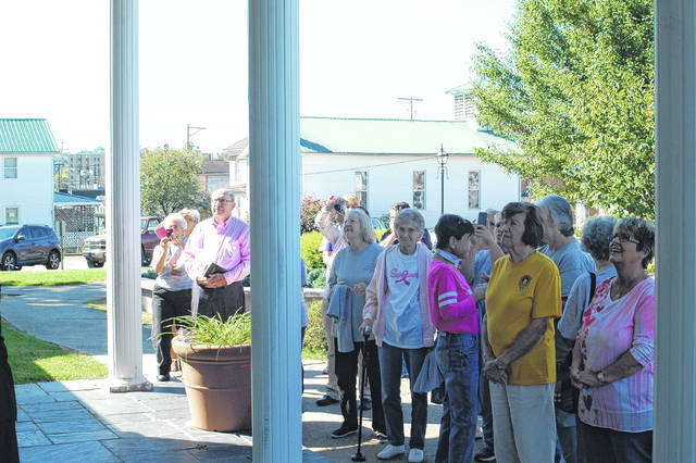 Several gathered at the Mason County Library at 11:30 a.m. on Friday to commemorate the beginning of Breast Cancer Awareness Month, which starts October 1.