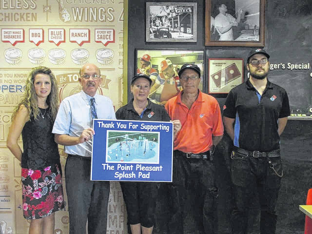 Owners of local area Domino's purchased one of the sprinklers to help raise funds for the Splashpad. From left: City Clerk Amber Tatterson, Mayor Brian Billings, owners Paula and Don Smith, and their son Alex.
