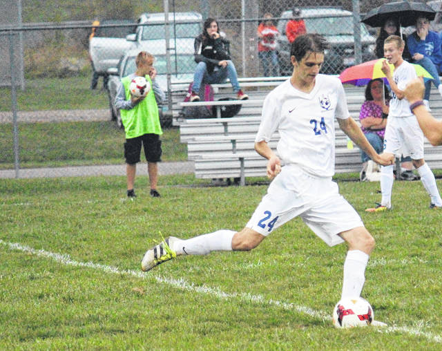 Gallia Academy senior Obie Reeves (24) kicks the ball during the Blue Devils' soccer match against Belpre on Tuesday in Centenary, Ohio.