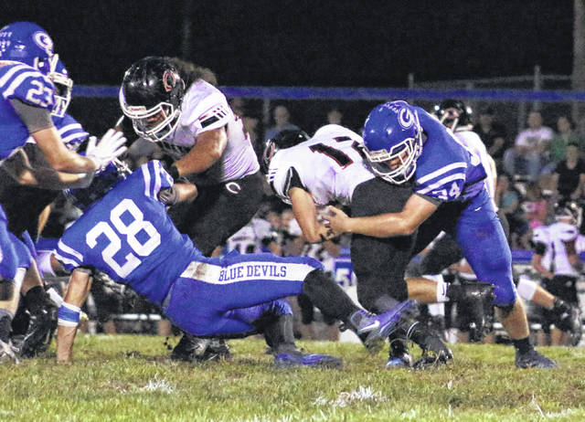 Gallia Academy sophomore Cade Roberts (34) wraps up a Coal Grove ball carrier during the second half of a Week 7 football contest at Memorial Field in Gallipolis, Ohio.