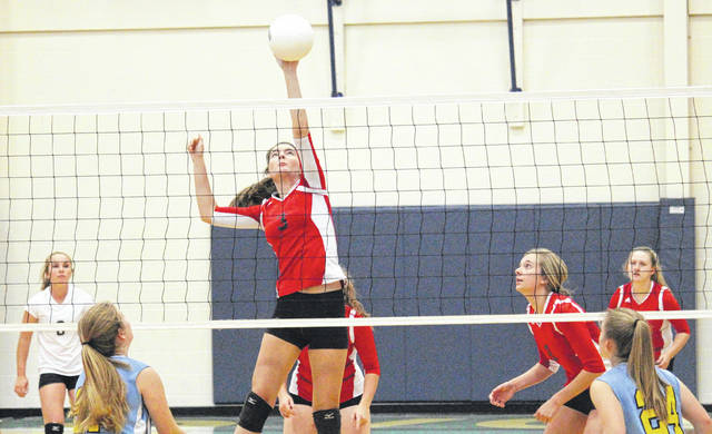 Point Pleasant's Brenna Dotson (3) goes up for a spike attempt as her Lady Knight teammates look on during Thursday's volleyball match at Ohio Valley Christian School in Gallipolis, Ohio.