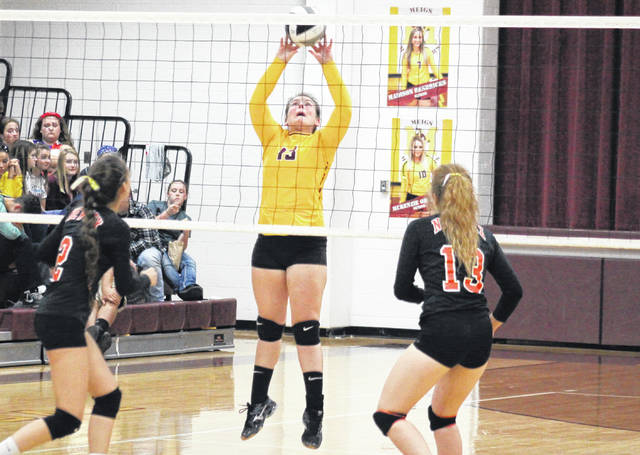 Meigs sophomore Saelym Larsen (center) hits the ball over the net during Lady Marauders' 3-1 win against New Lexington on Tuesday in Rocksprings, Ohio.