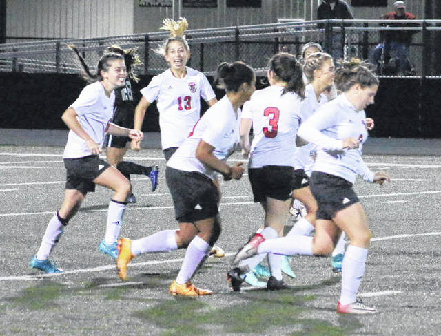 Point Pleasant sophomore Morgan Miller, left, is congratulated by Caitlin Peal (13) and other teammates following a second half goal Tuesday night in a Class AA-A Region IV, Section 1 semifinal against Sissonville in Point Pleasant, W.Va.