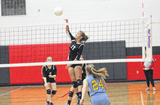 Point Pleasant's Haley Milhoan goes up for a kill over Ohio Valley Christian School's Makala Sizemore (24) during Tuesday's volleyball match in Point Pleasant, W.Va.